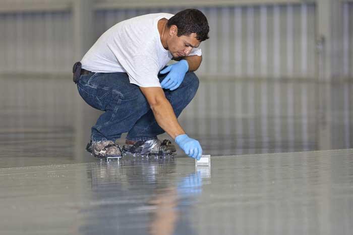 man applying epoxy orlando